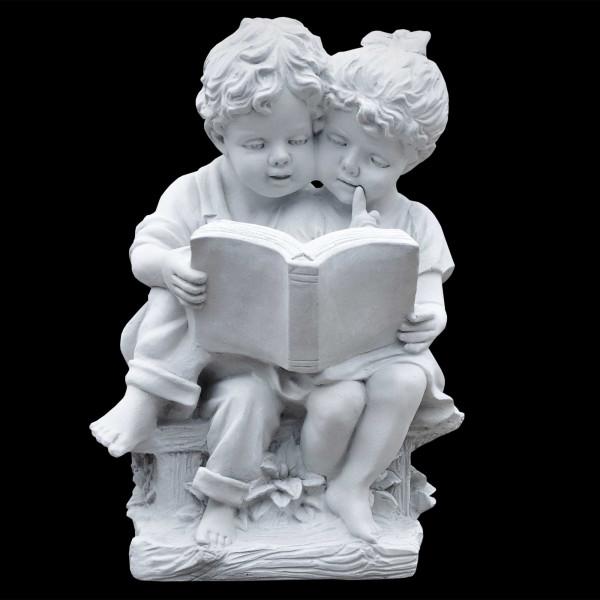 Steinguss Figur Junge und Mädchen lesen ein Buch