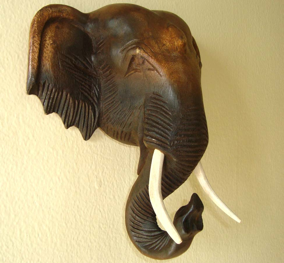 Hand Carved Wooden Elephant Head Wall Hanging: Elaborate circular ...